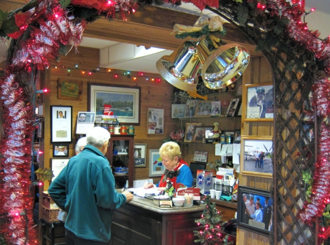 Pat Cannon, of C.J. Cannon's, helps patrons who stopped by for breakfast Sunday morning.  Now in their 29th year, the popular restaurant and lounge is a favorite of locals.