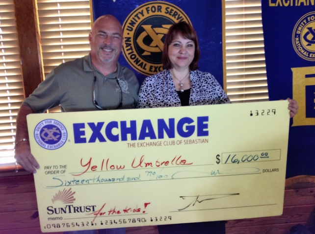 Michael Natale, President of Exchange Club of Sebastian, Terri Mermis, Executive Director of Yellow Umbrella