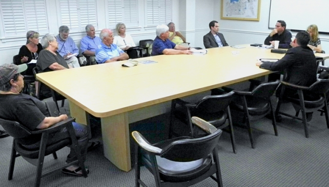 City Manager Jim O'Connor and representatives of Florida Power & Light meet with Councilman Jay Kramer to present the company's formal offer to purchase Vero Electric. Kramer invited members of the public to attend the meeting.