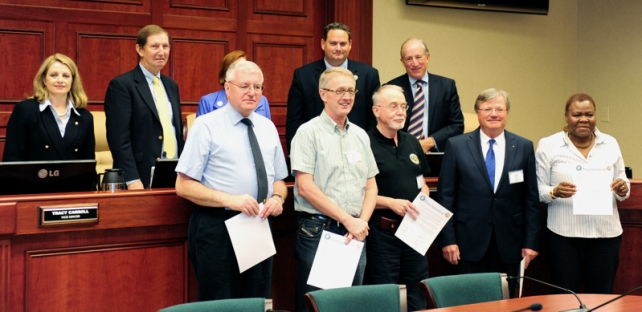 Rotarians Barry Picken, United Kingdom, Jan Lentvaar, Netherlands, Frank Ehlers, Germany, Jobst Isbary, Germany, Stella Dongo, Zimbabwe received a proclamation of welcome from the Vero Beach City Council.