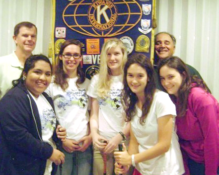 Kiwanians Kevin Brown (on left) and Al Sammartino (on right) flank Vero Beach High School Key Club officers (from left) Viri Morales, Rebecca Cosgrove, Laura Conger, Nicole McRostie and Dominique McRostie as they prepare for the Vero Kiwanis Annual Golf Tournament on Saturday, March 16 at The Club at Pointe West.