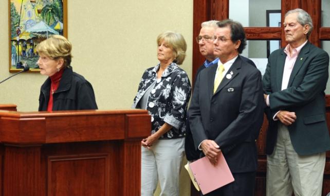Former Council members Deborah Fromang, BIll Jordan, Ken Diage and Sabe Abell, stook behind Caroline Ginn as she spoke before the Council.