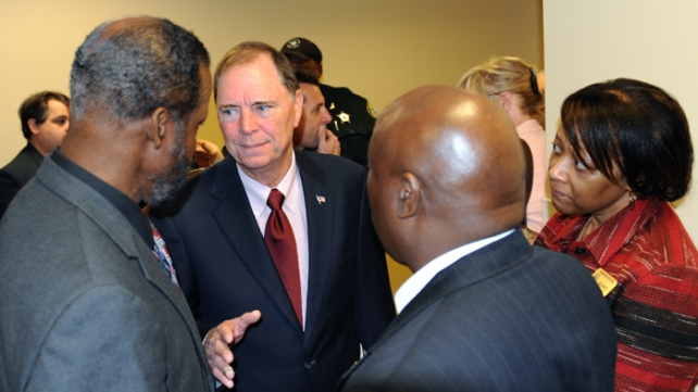 Fred Wilfork, Lindel Williams and Angela Perry, of the Gifford Youth Activity Center, speak with Congressman Bill Posey at the opening of  the congressman's new office Tuesday.