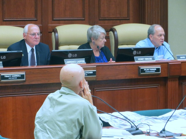 Board members Lawrence Lauffer, Honey Minuse and Mark Mucher; in foreground, Monte Falls, Public Works Director