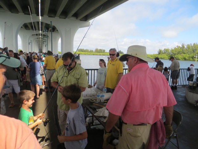 Kids and parents enjoy Kiwanis fishing tournament under Barber Bridge