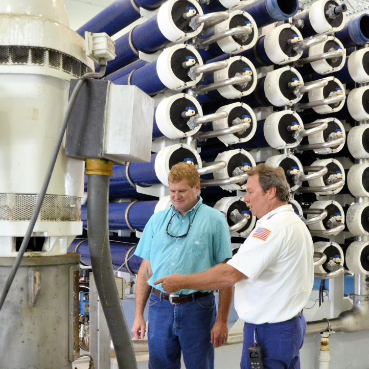 Vero Beach Water and Sewer Utility Director Rob Bolton, left, and water treatment plant operator Jeff Howard inspect the city's reverse osmosis water filtration system