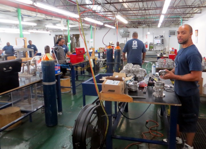 workers in the finishing room prepare valve assemblies for final inspection.