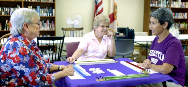 Sebastian City Councilwoman, Andrea Coy, visits with participants and the Sebastian Senior Activity Center.