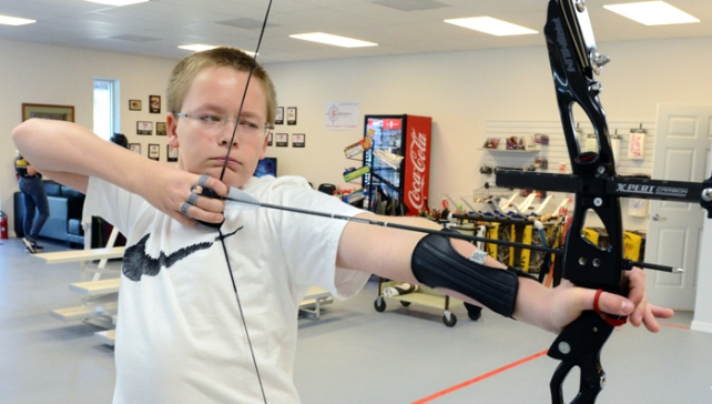 Thirteen-year-old Caleb Lundeen is a national champion archer.