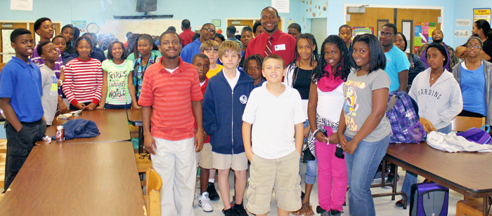 """Guest """"mentor"""" speakers often meet with the children at the Gifford Youth Activity Center stressing the importance of getting a good education."""