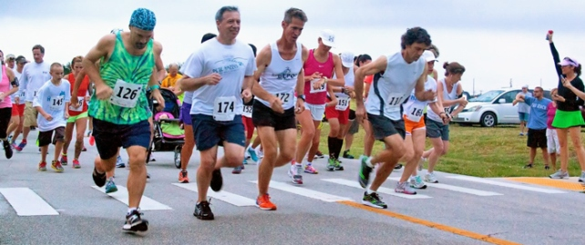 Runners take off from the Airport starting line at the 2013 Hibiscus Festival 5K.