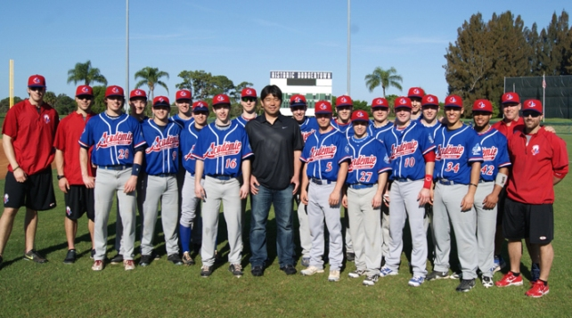 Former Dodger and Japan Hall of Fame inductee, Hideo Nomo, stands with Academie Baseball Canada team members during warm-ups of their Sunday game at Historic Dodgertown.  Nomo, a Founding Partner of Historic Dodgertown with Peter O'Malley, returned to visit the facility this weekend and viewed baseball and softball activities in action.