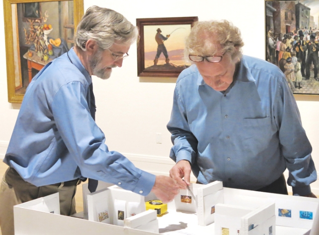 Williams with Walter Wick in April, looking at the scale model of Holmes Gallery and discussing the final layout of works of art in his summer exhibition.