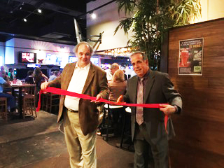 Larry Fiorella and Darrell Peterson snipped the red ribbon to their new sports bar Blue 42 at 710 S. US one (South East corner of US1 and Oslo Road)