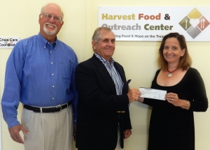 Peter B. Lake and Tom McGinnis from Grand Harbor Community Outreach present Annabel Robertson, Executive Director of Harvest Food & Outreach Center of Indian River County with $15,000 grant to support HOPE Program.