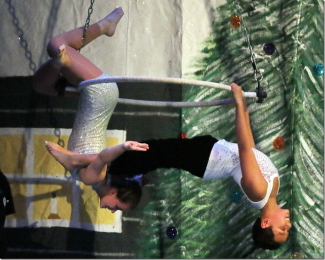 Micah Nalzaro and Taryn Sovine performing on the spinning hoop - Photo by Jim Cole