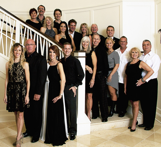 Couples paired for the new season of Dancing with Vero's Stars are: (On staircase from top to bottom) Jan Mason Cilento and Robert Scott; Deb Polackwich and Barry Trammell; Marianella Tobar and Bobby Sexton; Jackie Savell and Bob Kane; Eric Flowers (partner Beth Shestak missing from photo), Susie O'Toole and Joe Wynes; Shari Tessier and Lee Olson; Karren Walter and Andy White. (Bottom of stairs) Amy Trammell and Tom Lowther; Karen Franke and Joe Tessier - Photo courtesy of the Indian River Photo Club