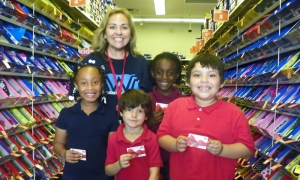 Indian River Academy Principal Diane Fannin and her students benefit from the Payless Gives Shoes 4 Kids program.