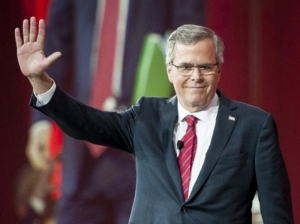 Former Florida governor Jeb Bush waves to the crowd as he arrives to address CPAC on Friday. (Pete Marovich/European Pressphoto Agency)