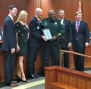 Indian River County Sheriff's Deputy Teddy Floyd with Gov. Rick Scott and the members of the Florida Cabinet.