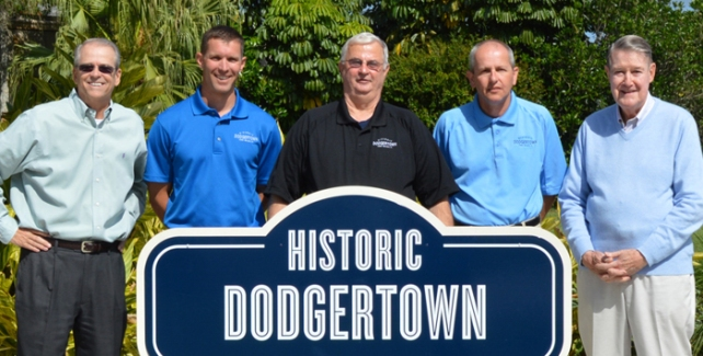 (L-R) Craig Callan, Brady Ballard, Steve Snure, Jeff Biddle and Peter O'Malley pose in front of the Conference Center sign at Historic Dodgertown.