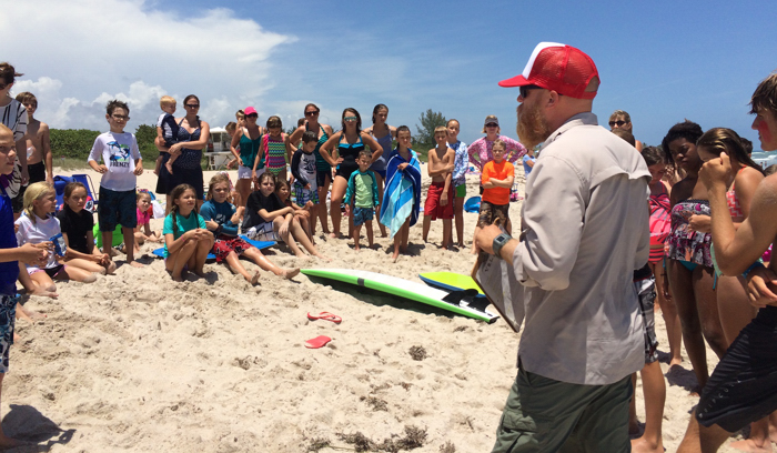 Tim Capra, Vice President of the Vero Beach Lifeguard Association, teaches students from Classical Conversations at South Beach Park