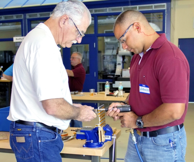 Harry Brubaker, Production Trainer, Piper Aircraft, provides direction to Antonio Rivera, during IRSC's Fast Track to Manufacturing Program.