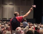 weekend - A man waves the flag at a Space Coast Symphony patriotic concert